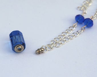 Blue glass pendant necklace acting vial perfume
