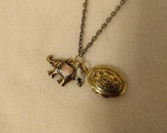 Gold locket and elephant charm necklace