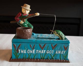Vintage Fisherman Cast Iron Bank - The One That Got Away
