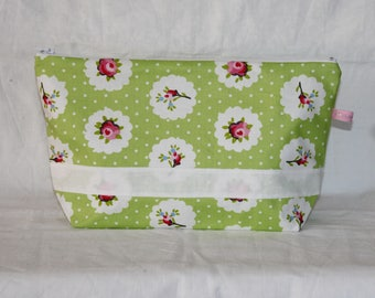 Toiletry bag, travel in green coated with flowers