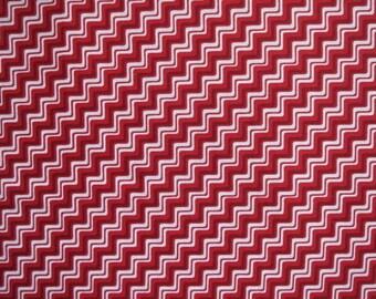 Tissu graphique blanc sur fond rouge, largeur 110cm