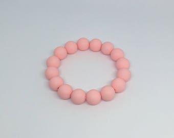 Pink silicone teething ring