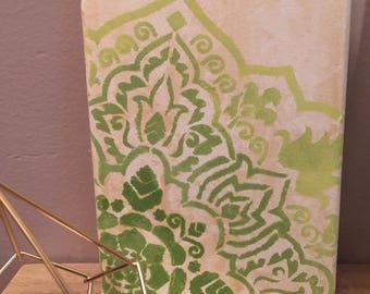 Green mandala painting on canvas