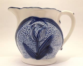 Vintage jug pitcher blue and white embossed rose milk jug