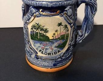 Florida Souvenir mug, Vintage. Ceramic. 1960's. Features flamingo's and palm trees.