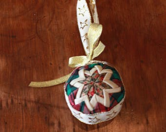 Patchwork quilted Christmas bauble.