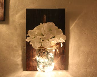 Mason Jar decor with lights and flowers