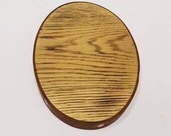 Burnt oak oval board