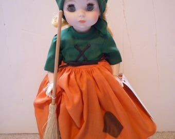 """Madam Alexander Poor Cinderella Doll / 12"""" tall, with tag, on a stand, still with original box"""