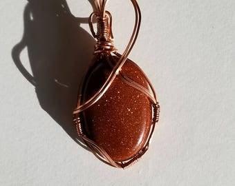 Sun stone wrapped in copper wire