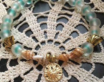 Beaded bracelet, sand dollar, jewelry