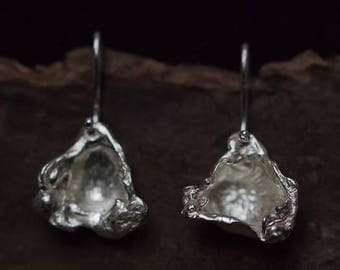 Triangle shaped casted silver earrings