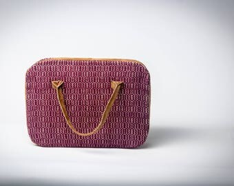 Handwoven handbag with leather details