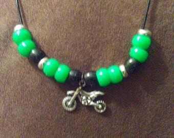 Motocross dirtbike necklace with KX colored beads on a leather cord.