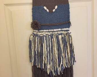 Blue woven wall hanging