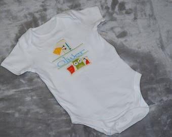 embroidered 1st birthday baby bodysuit with a personalised name