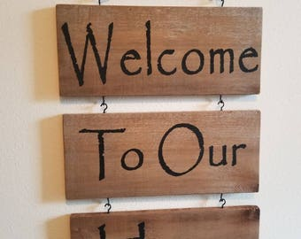 Welcome To Our Home wooden sign.