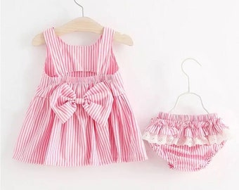 Pink and white dress and frilly knicker set