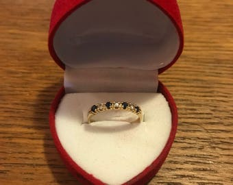 Vintage golden ring with sapphires and zirconias