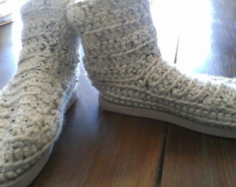 hand crocheted, cream colored house boots with a flip flop sole.