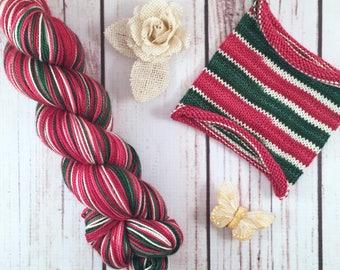 Merry And Bright Dammit: Hand-dyed self-striping sock yarn, 80/20 SW merino/nylon