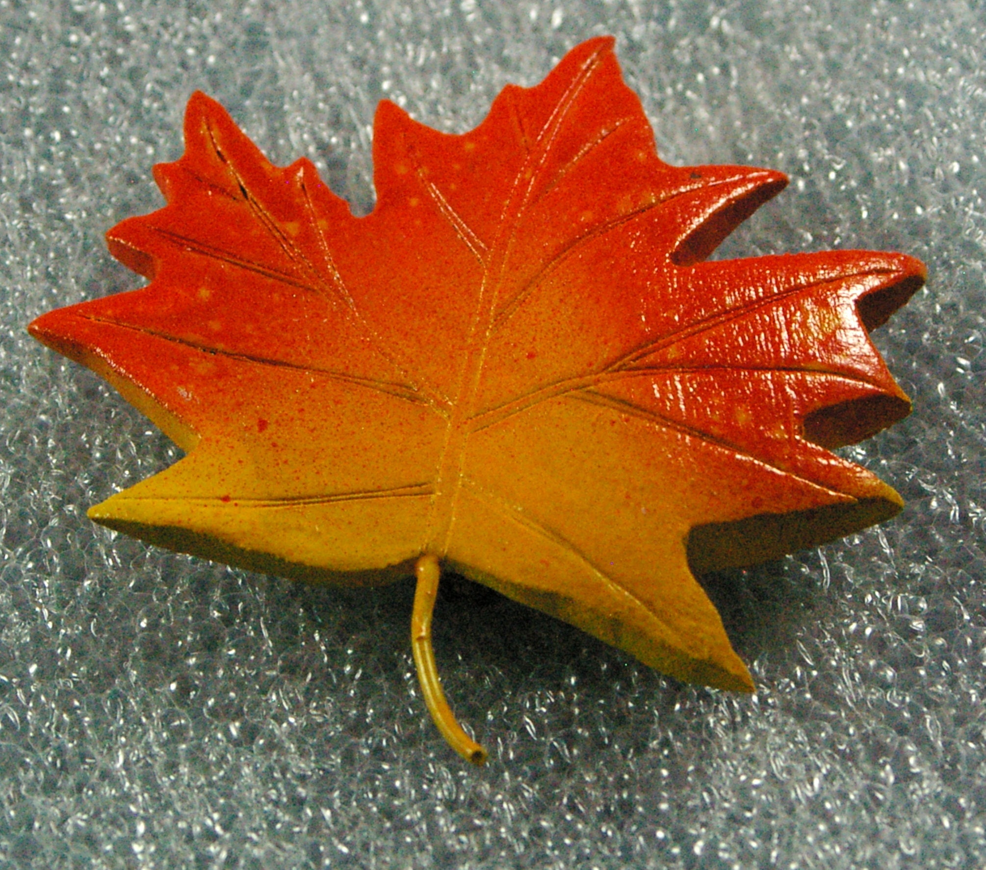 Woodcarved sugar maple leaf in fall colors
