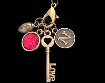 """Nebraska Charm Necklace -18"""" Antique Bronze chain-Four Charms- Initial N, Red Jewel, Love Key, Football- Go BiG ReD"""