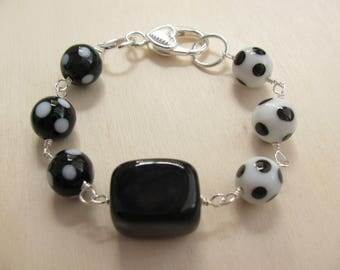 Bracelet with polka dot beads and black onyx bead. Dotty bracelet. Black and white bracelet