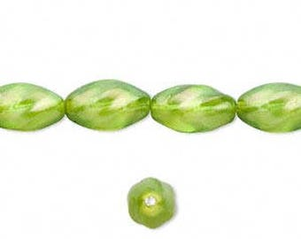 Czech Glass Bead 12x7mm twisted oval: 30 pieces UNSTRUNG - Pearlized Light Green Pressed Glass Bead