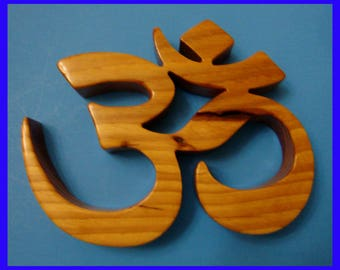 Handmade Om Made from a single piece of Pecan Wood