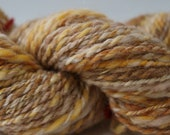 75 yards tan handspun yarn, 2 oz.