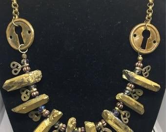 Vintage escutcheon crystal point necklace