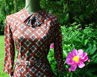 Fall fashion vintage 60s,brown polyester, mod style dress with geometric print. Made by Casualmaker. Size medium.