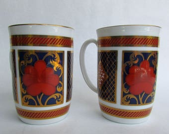 Empress by Fitz & Floyd 2 Porcelain Mugs, 1980-1986, Rust Flowers On Cobalt Blue w/ Gold Decor