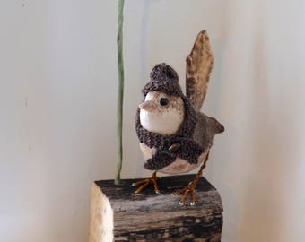 Wee painted cotton wren with seed head and hand knitted hat, scarf. Textile bird sculpture on driftwood.