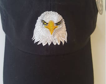 Unstructured Baseball Cap embroidered with an embroidered design of a bald eagle head.