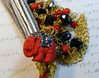 Cinnabar Elephant-glass beads and gld chain, leather tassel, 31 inches or 79 cm