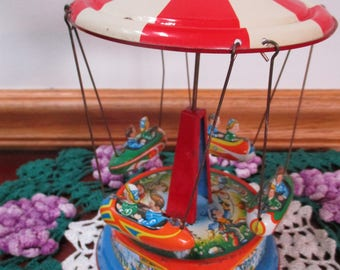 JW  Tin Colorful Litho  Rocket Ships Merry Go Round-   Pull Leaver Go Western Germany
