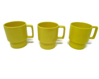 yellow cups vintage cups retro cups stackable cups plastic cups kitsch