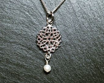 Sterling silver flower necklace with freshwater pearl accent