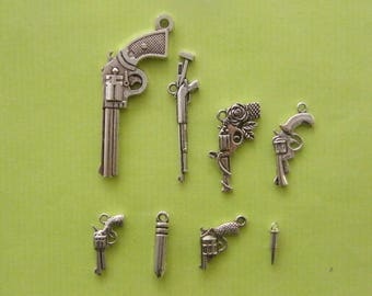 The Gun Collection - 8 different antique silver tone charms