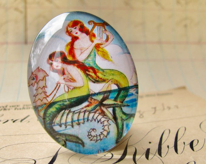 Mermaids on a Seahorse illustration, 25x18mm handmade glass oval cabochon, orange, yellow, aqua, vintage drawing