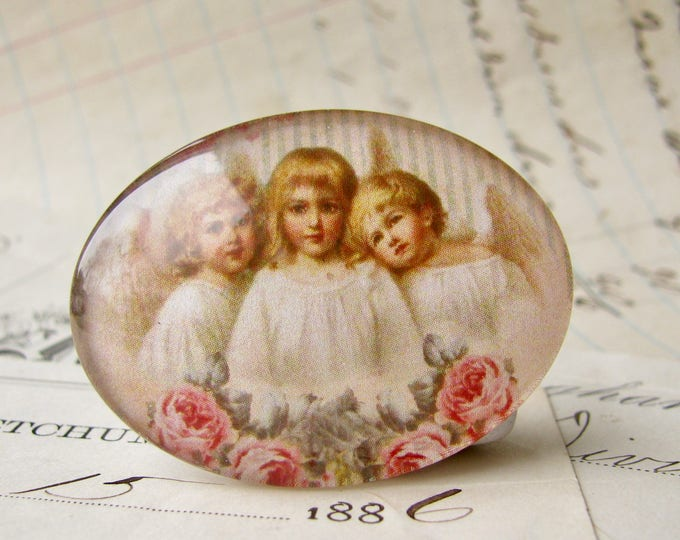 Horizontal cabochon, three Victorian cherubs, angel image, pink roses, handmade glass cabochon, 40x30mm, sideways oval, winged, angel wings