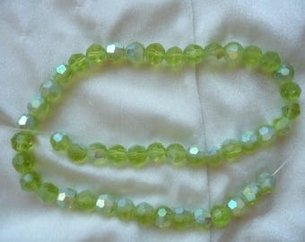 Bead, glass, Lime Green AB, 8mm faceted round.  Sold per 13 inch strand.  There are 47 beads on this strand.
