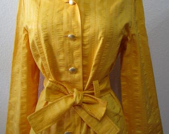 Vintage yellow color coat with gold color buttons and a belt plus made in USA (C64)