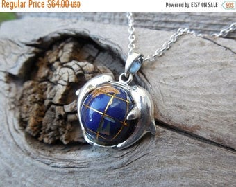 ON SALE World globe necklace handmade in sterling silver with a kissing dolphin frame
