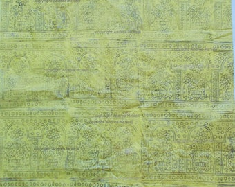 Sheet of yellow tissue paper handprinted with Indian woodblock print