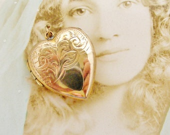 Vintage embossed rolled gold heart locket with a hint of rose gold