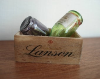 Miniature wooden crate with bottles