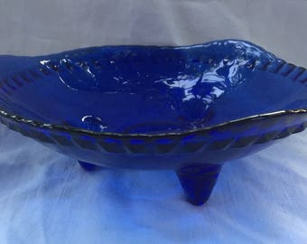 A pretty, vintage cobalt blue footed glass dish.
